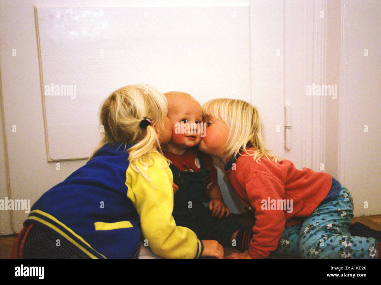 two boys kissing one girl