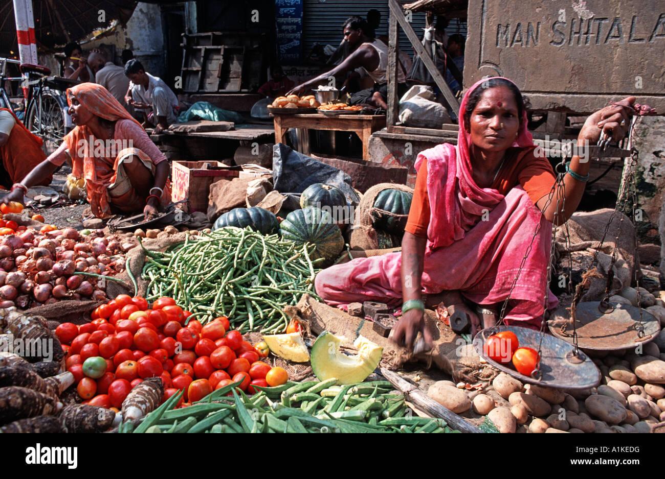 Indian woman vending fruit and vegetables at a market in Varanasi Uttar Pradesh India - Stock Image