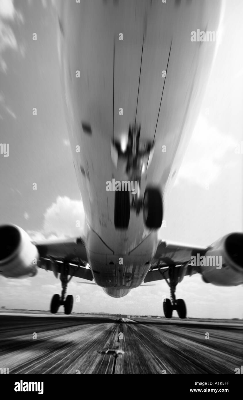 Airbus passenger aircraft landing on runway - Stock Image