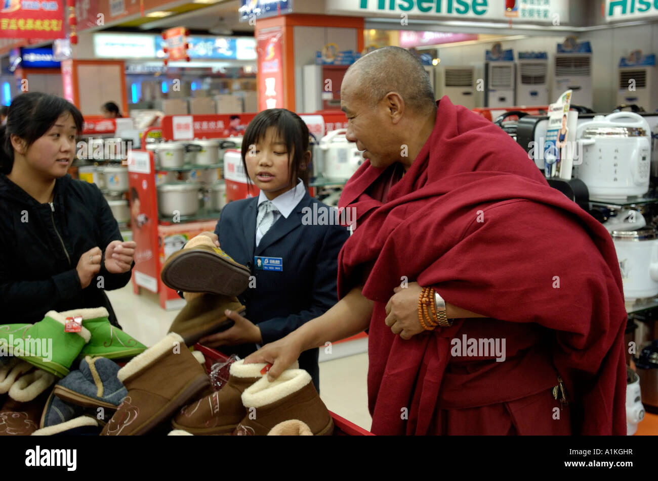 Tibetan monks shopping in a supermarket in Lhasa Tibet China 22 OCT 2006 - Stock Image