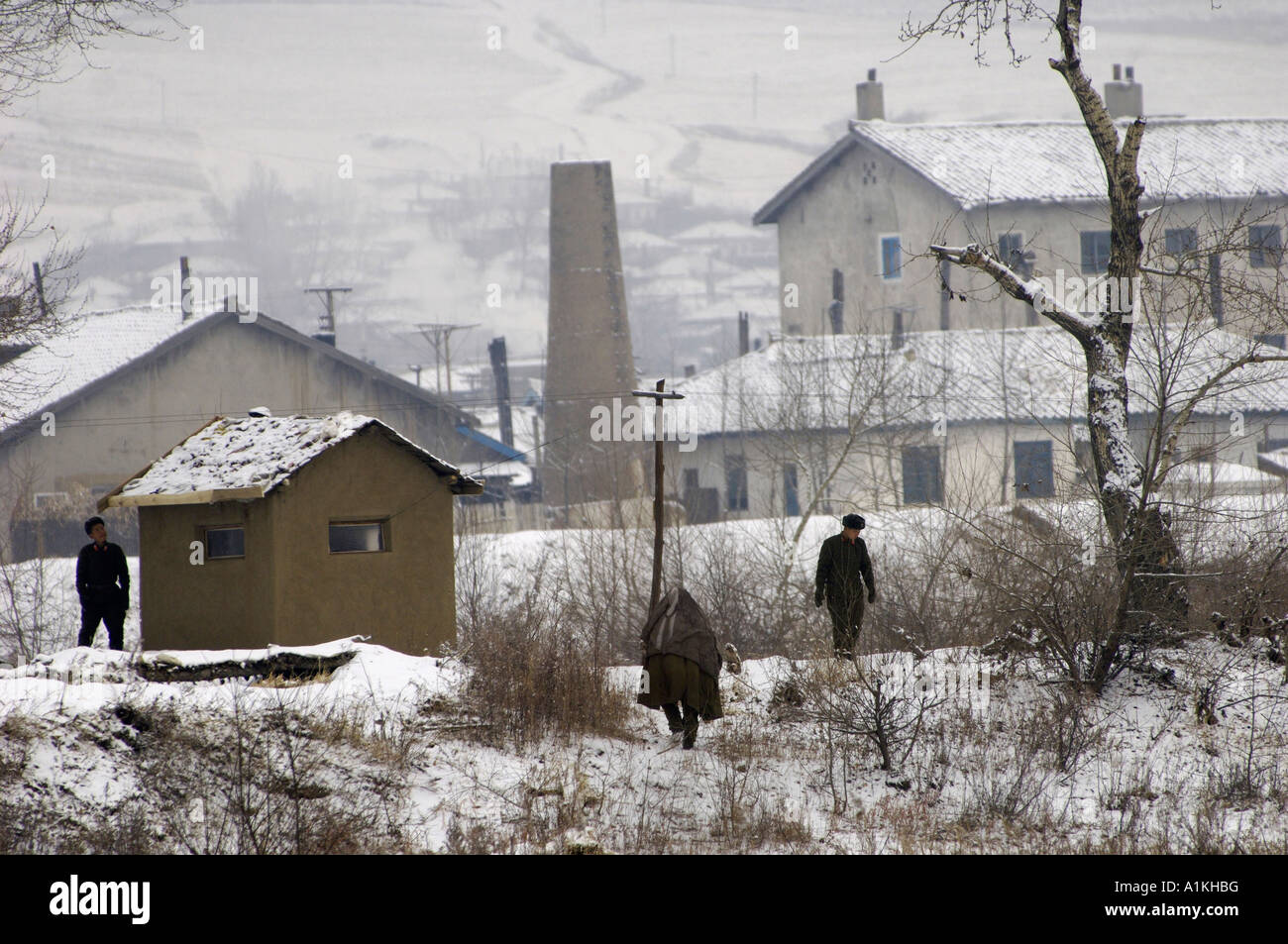 North Korean soldiers patrol the border in Namyang the other side of the Tumen river in northeast China s Jilin - Stock Image