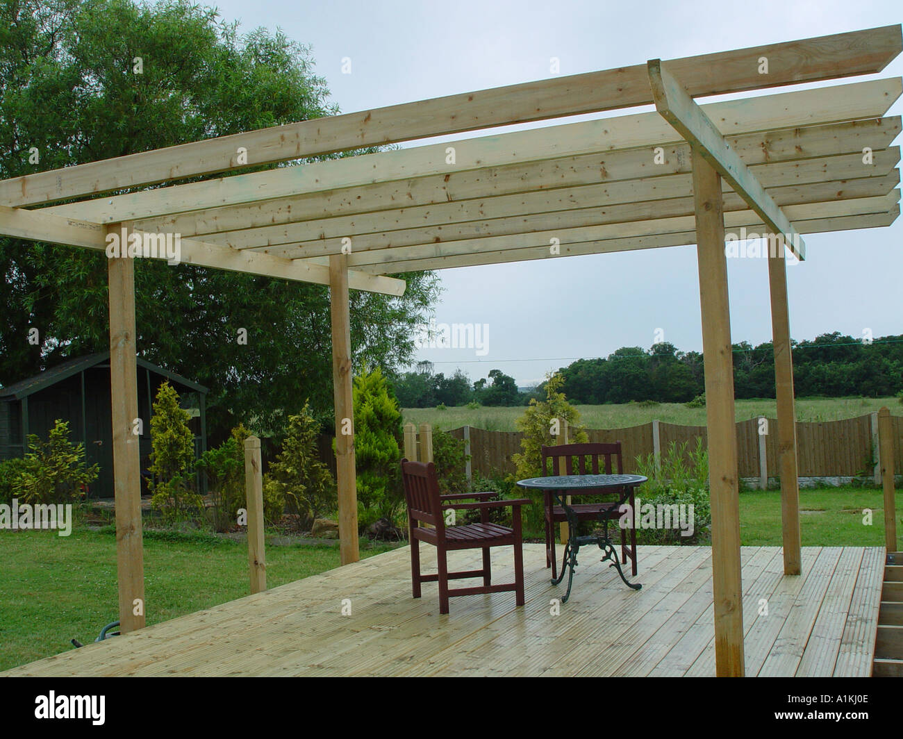 Pergola over garden patio deck the decking and pergola are constructed from  tanalised timber for long life - Pergola Over Garden Patio Deck The Decking And Pergola Are Stock