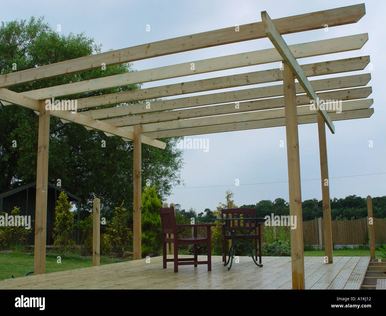 Pergola over garden patio deck the decking and pergola are constructed from  tanalised timber for long - Patio Timber Deck Pergola Stock Photos & Patio Timber Deck Pergola