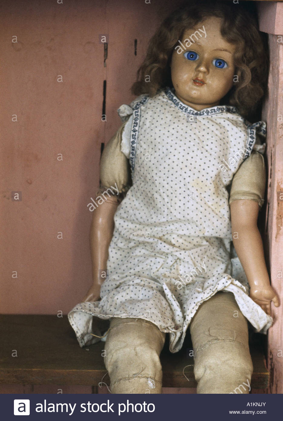 old doll sitting on a shelf stock photo 10283954 alamy