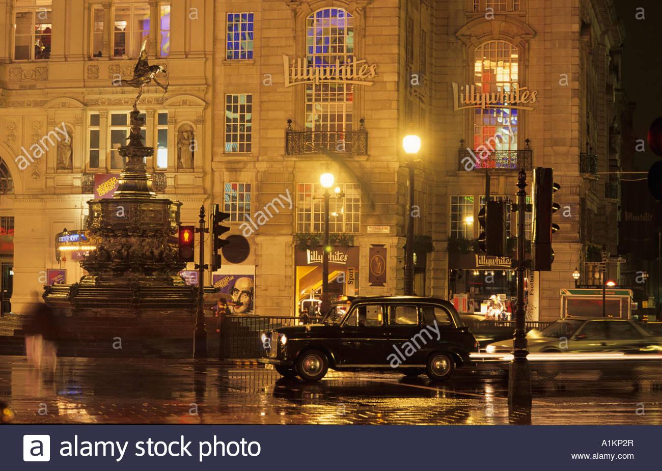 Taxi at Picadilly Circus, London - Stock Image