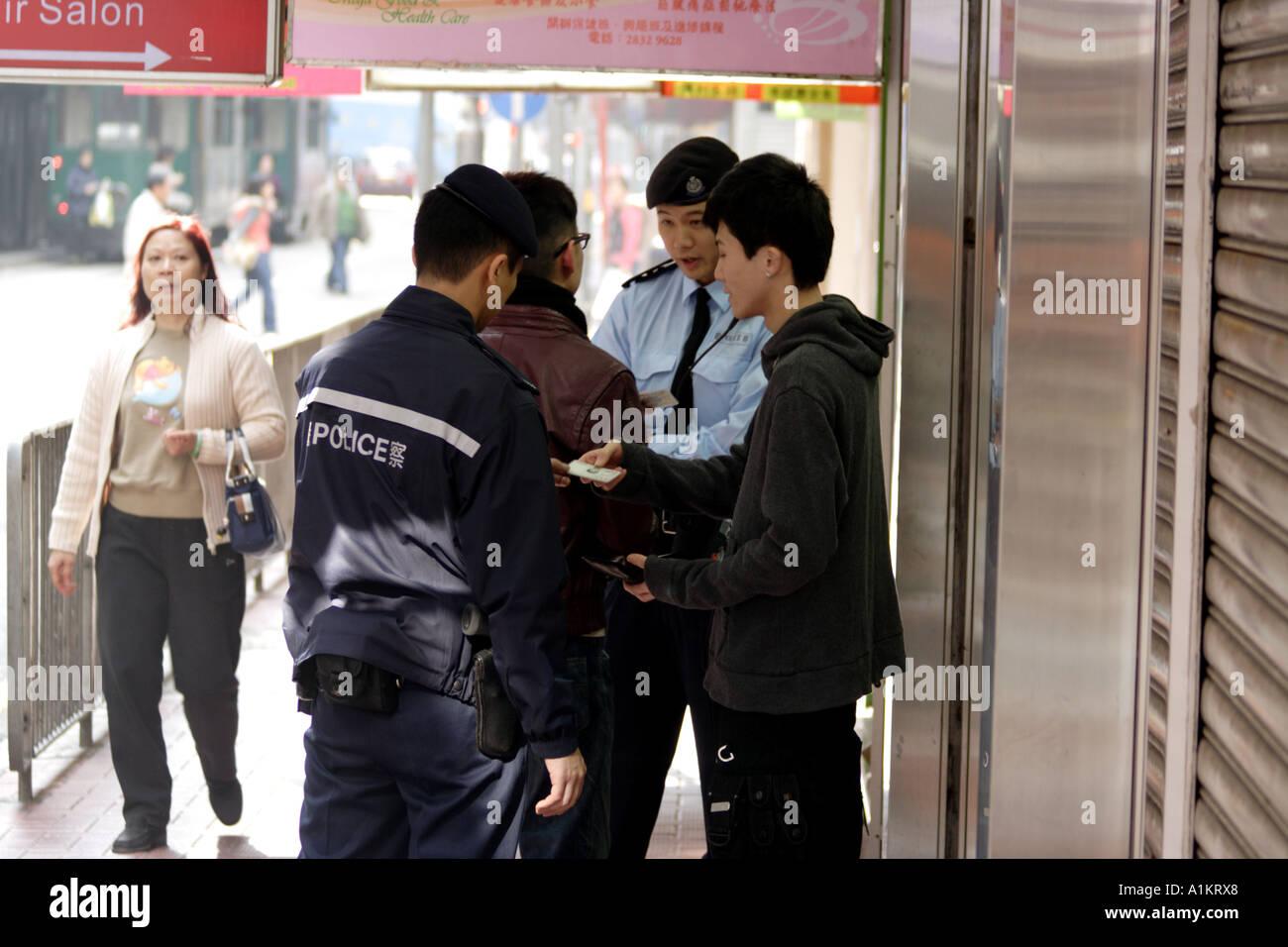 Random search by police, Causeway Bay, Hong Kong - Stock Image