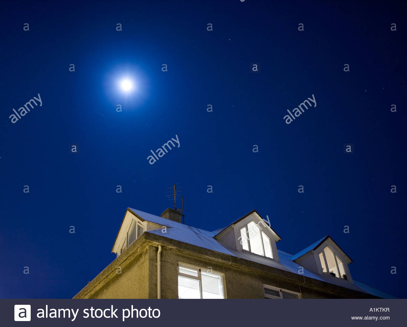 Moon shining over a house in Reykjavik, Iceland - Stock Image
