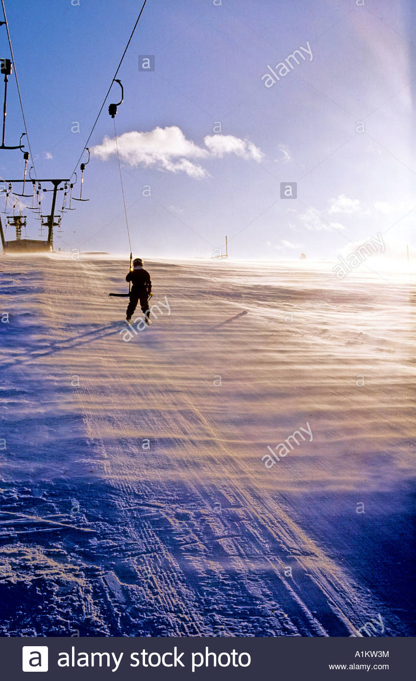 Rear view of a person taking a skilift in Sweden Stock Photo
