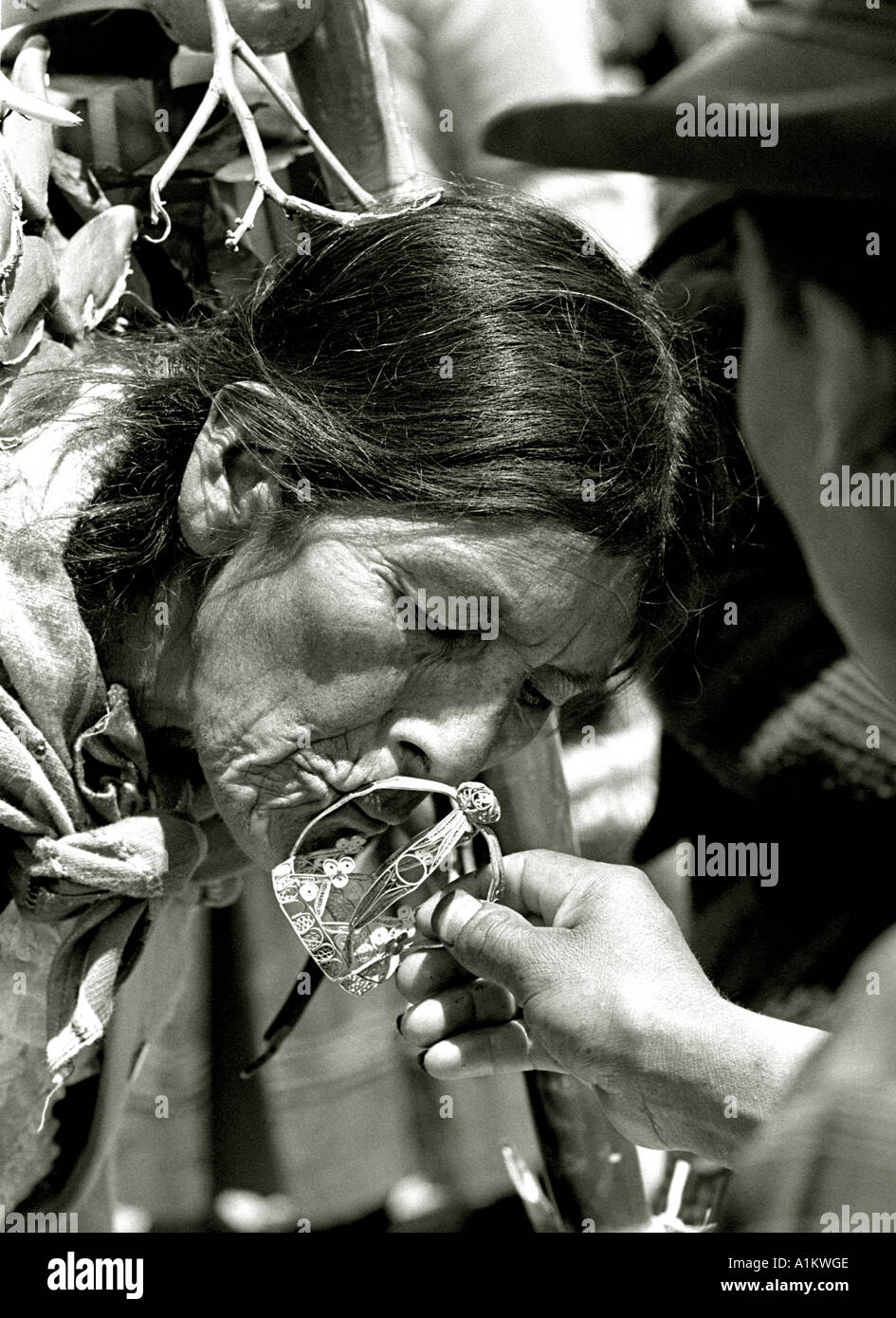 Indian woman kissing the crown of miracles at the festival of the virgin of Cocharcas in Sapallanga Huancayo peru andes - Stock Image