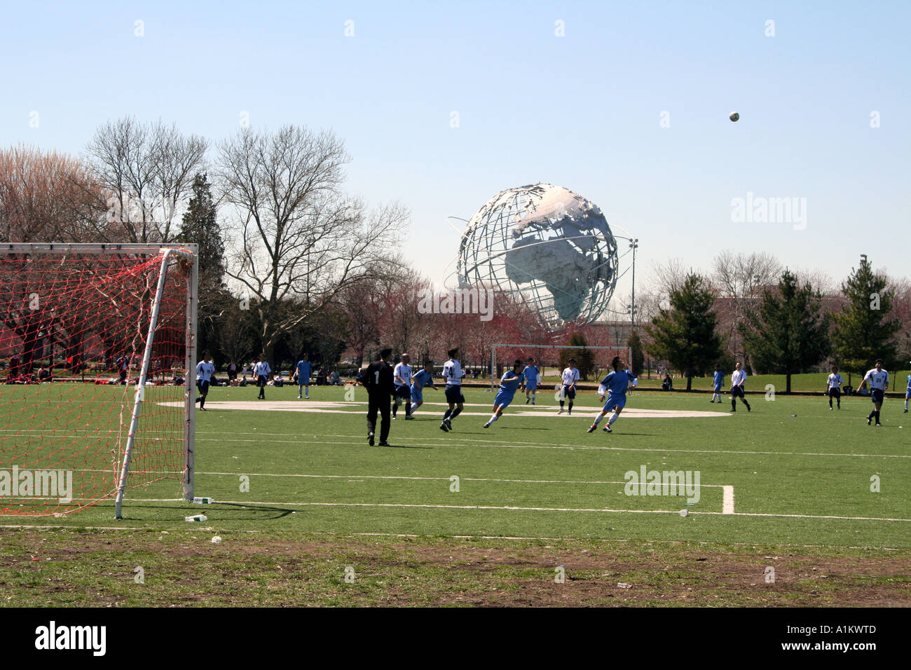 Football (Soccer) ball in flight in front of Unisphere, Queens NYC - Stock Image