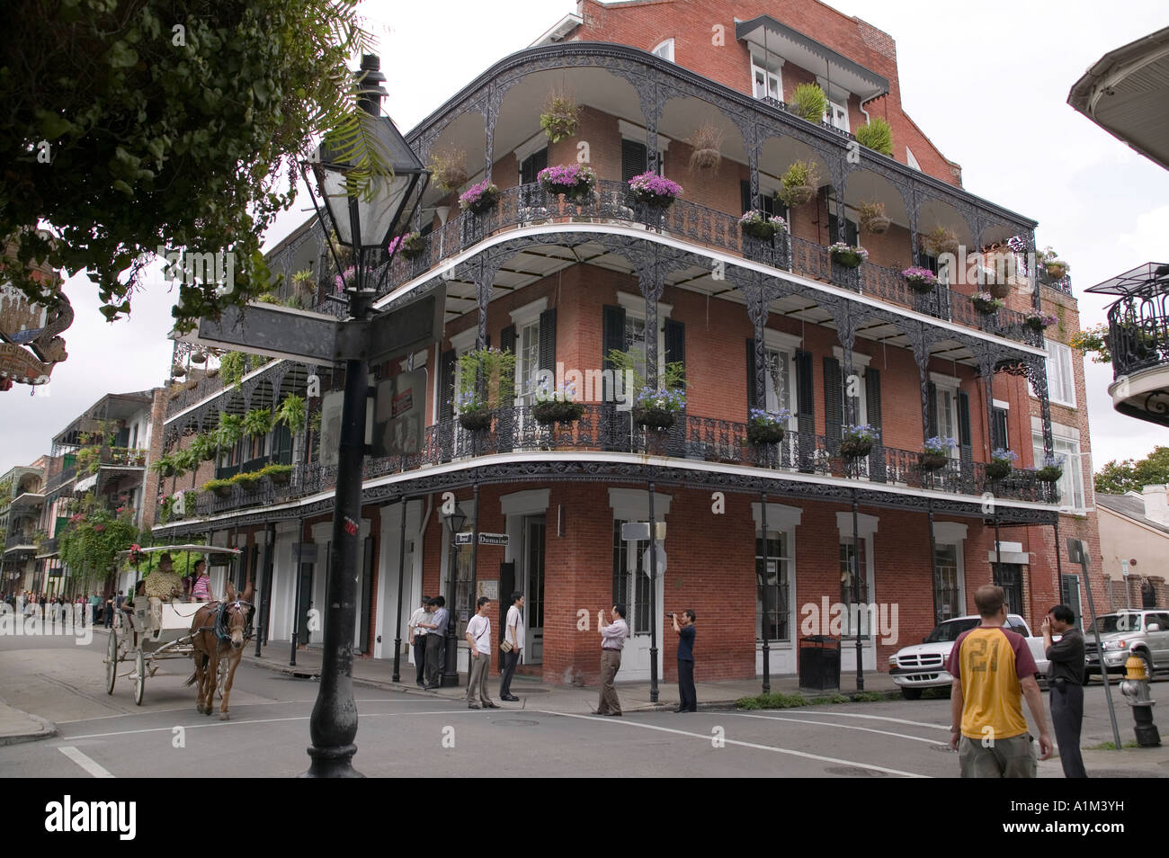 A Street Scene With A Building With A Long Veranda On Corner In New Stock Photo Alamy