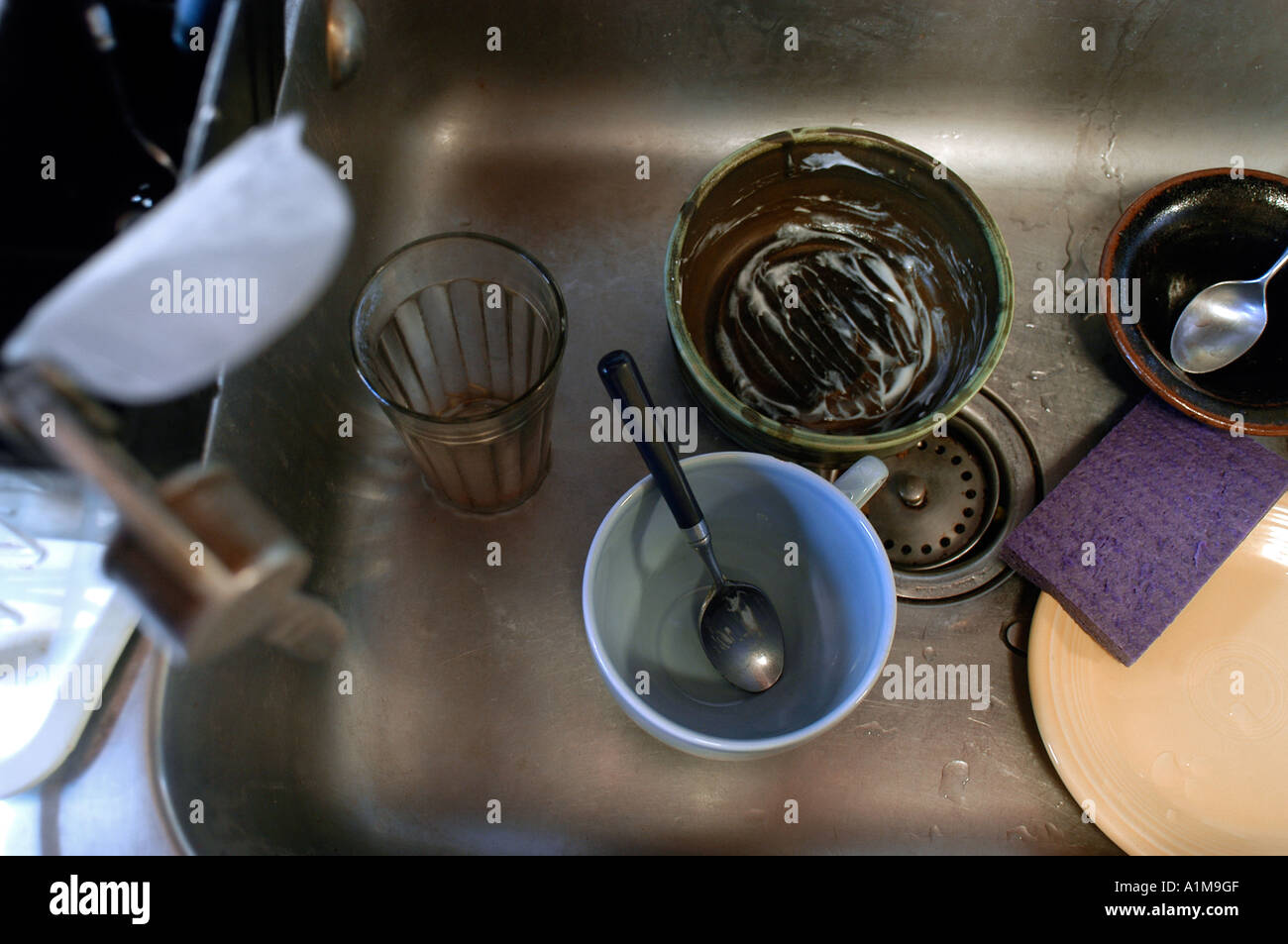 Dirty dishes in a dirty sink Stock Photo