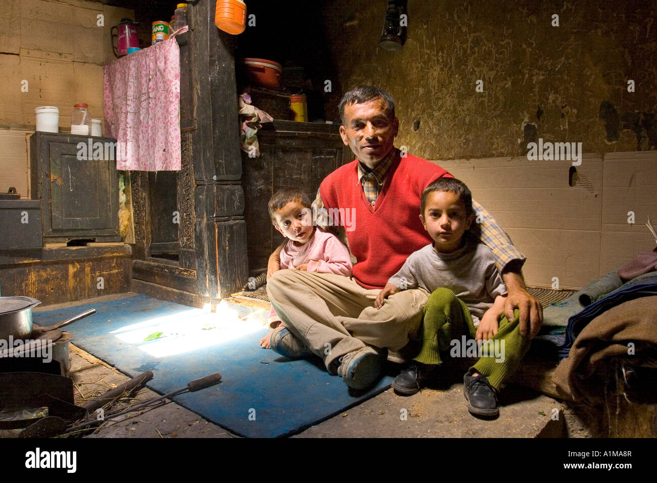 Father with his children, Karimabad, Pakistan - Stock Image