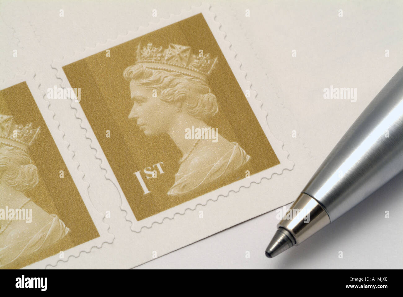 United Kingdom First Class Postage Stamp and Pen - Stock Image
