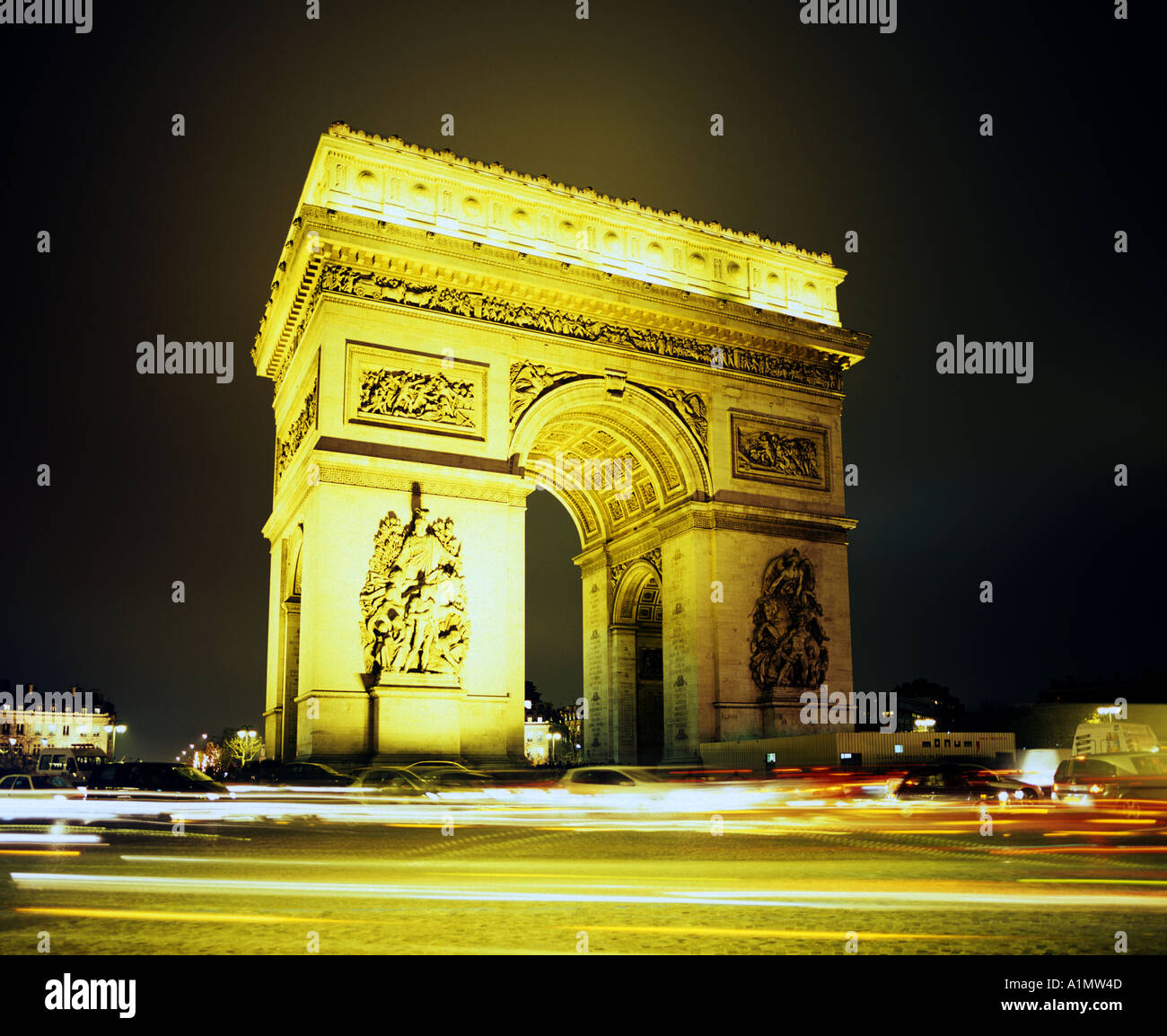 A night view of the Arc de Triomphe in Paris France - Stock Image