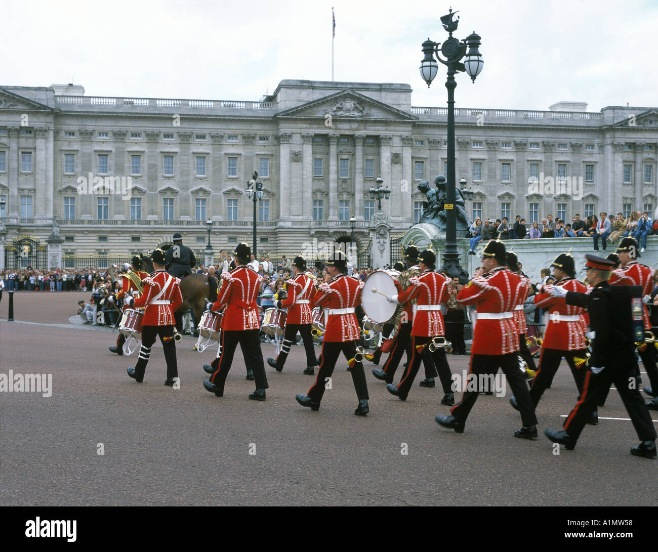 A marching band in front of Buchingham Palace in London England Stock Photo