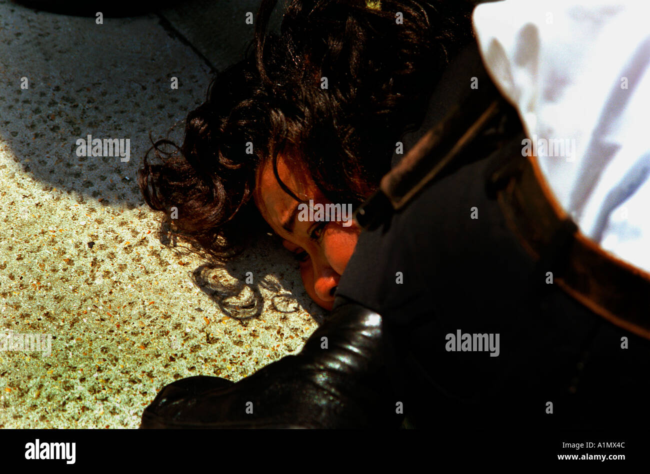 Police officer arresting black woman crime suspect in  South London - Stock Image