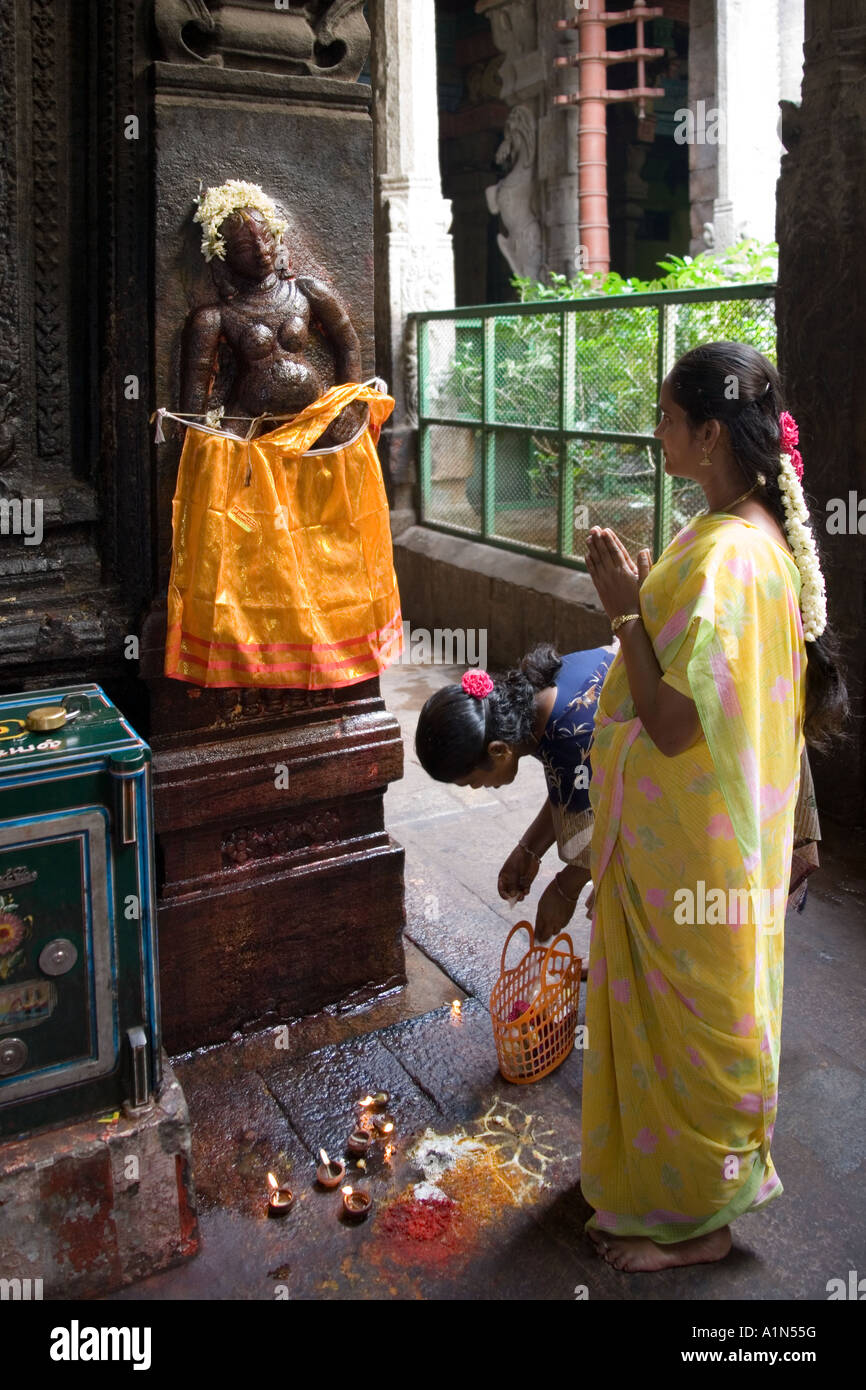 Pregnant Indian women pray for a safe birth to a Hindu deity at the