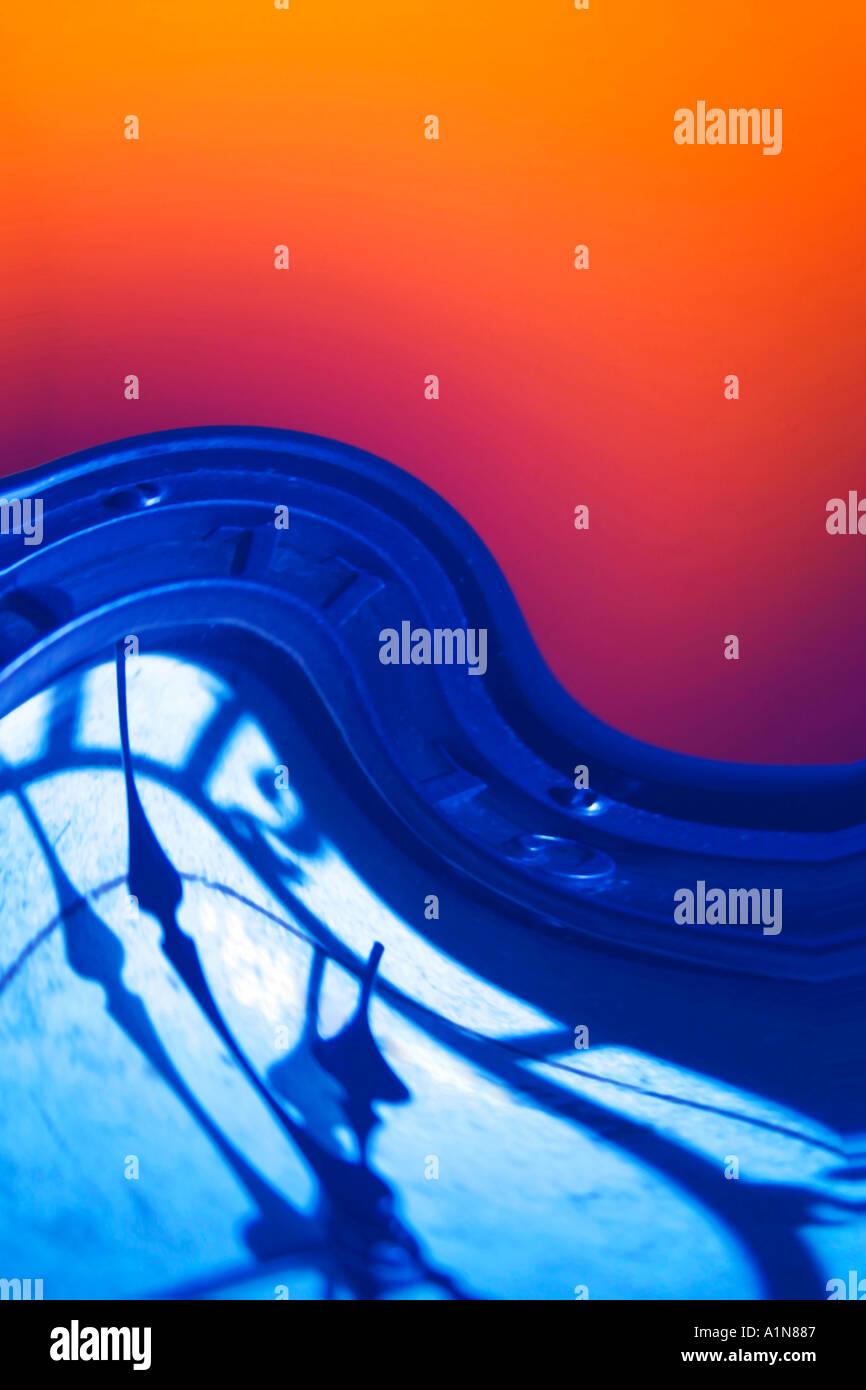 Wave Clock in Blue Tone on Orange Background Digital Art  - Stock Image