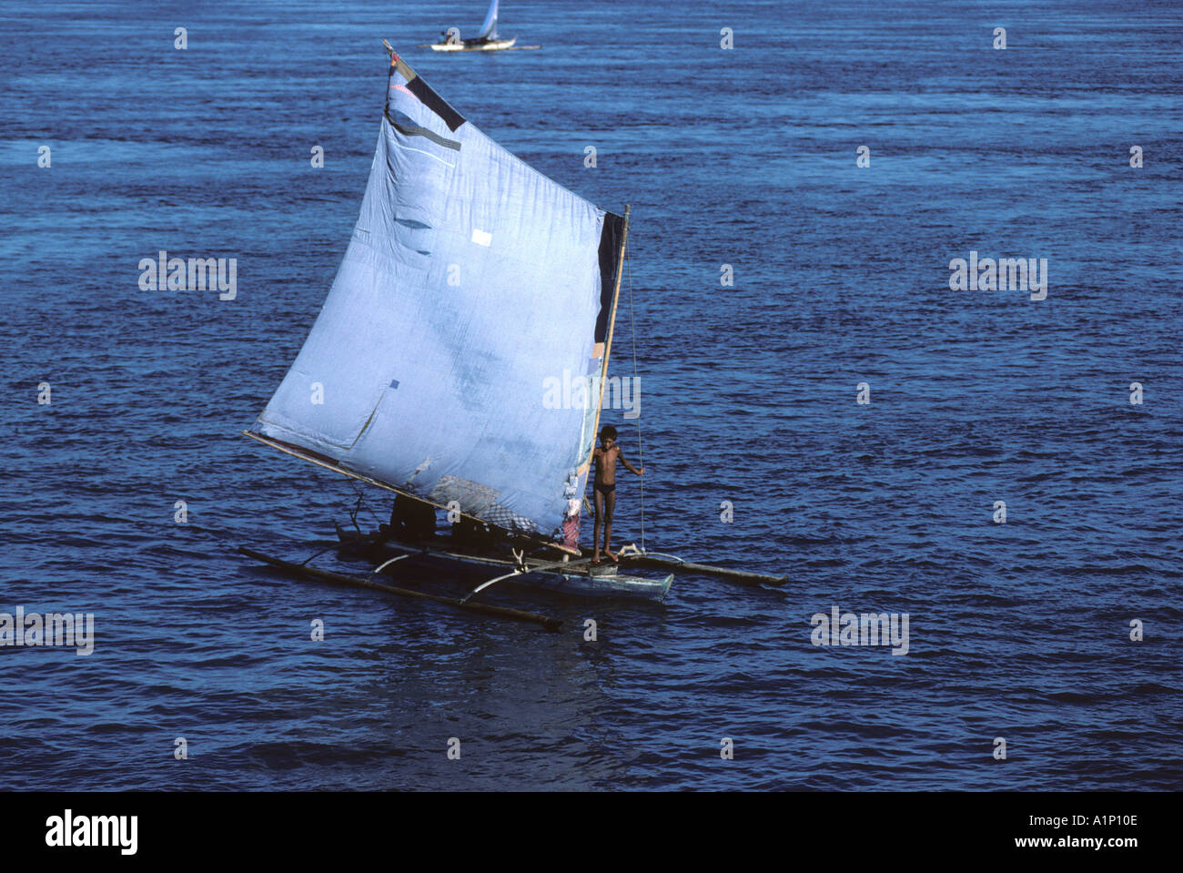 Sailing Vinta outrigger canoe Badjao Badjao or Tau Laut sea gypsies Basilan Island Mindanao Philippines - Stock Image