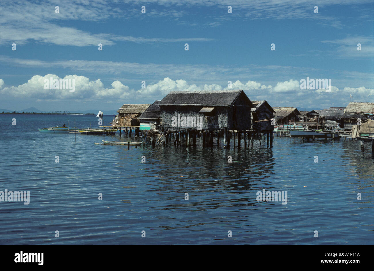 Taluksangay village on stilts over the sea near Zamboanga Badjao Badjau or Tau Laut sea gypsies Mindanao Philippines Vinta - Stock Image