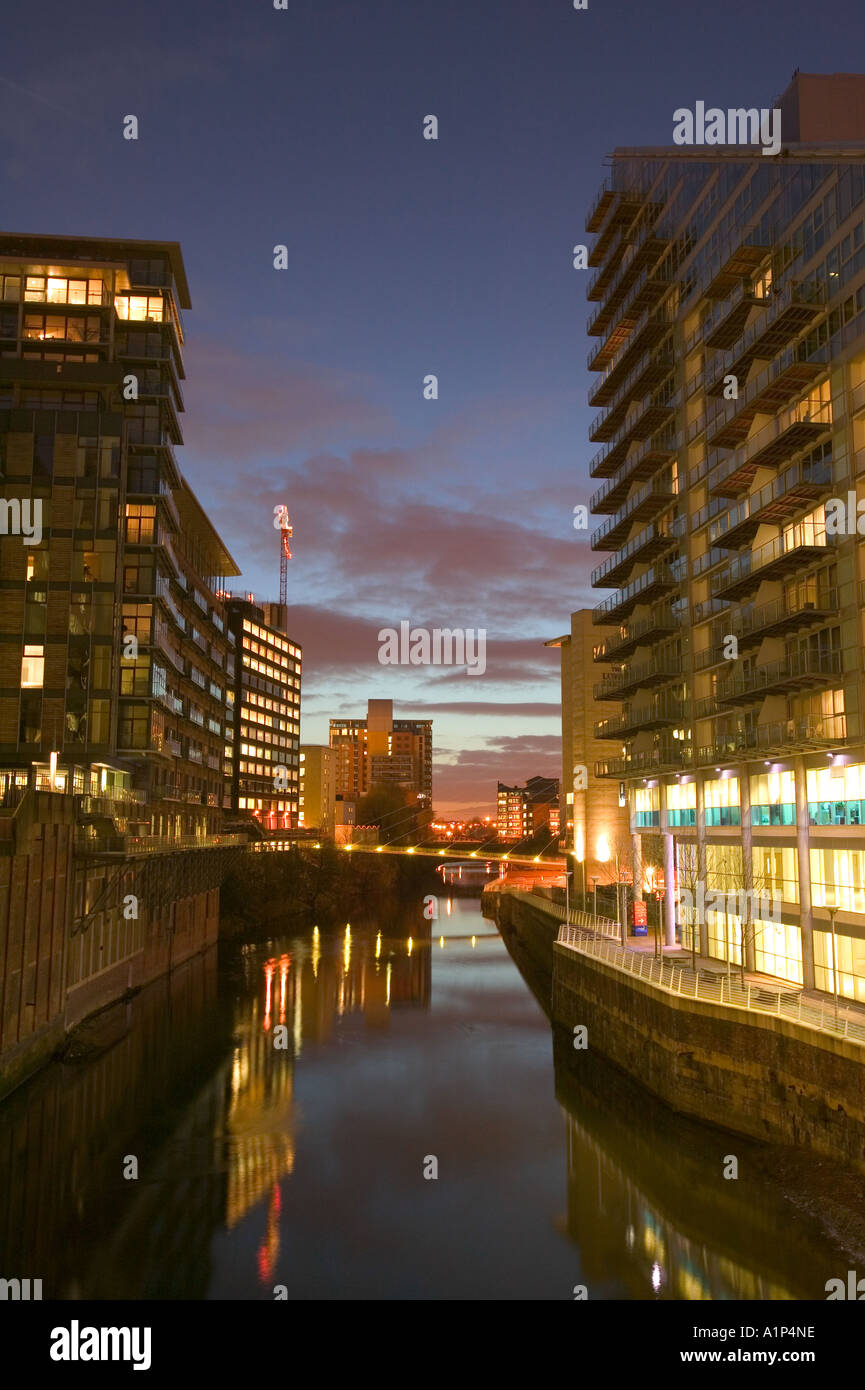 modern luxury apartment blocks on the side of the River Irlam in Manchester city centre - Stock Image