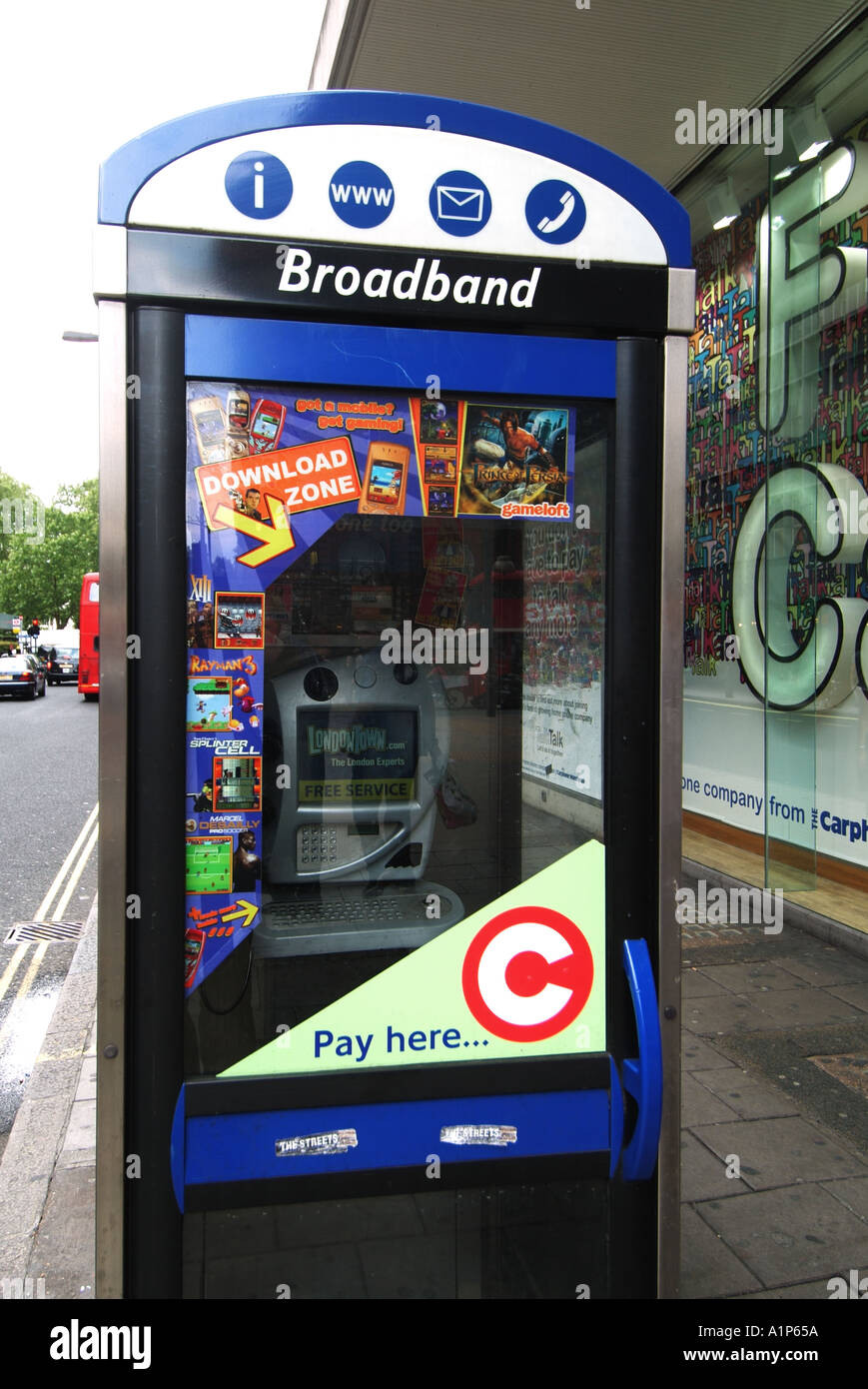 London City of Westminster pavement phone box with signs for web and email access as well as payment of congestion charges - Stock Image