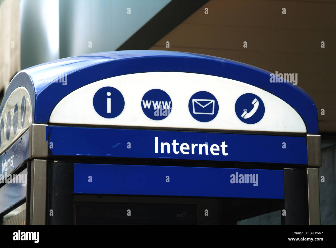 London City of Westminster roof of pavement phone box with signs for web and email access - Stock Image