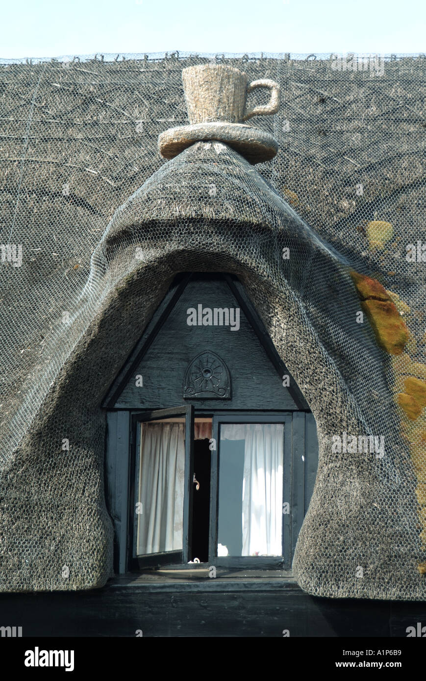 Part Of Thatched Roof Over Caf Showing Eyebrow Window Complete With