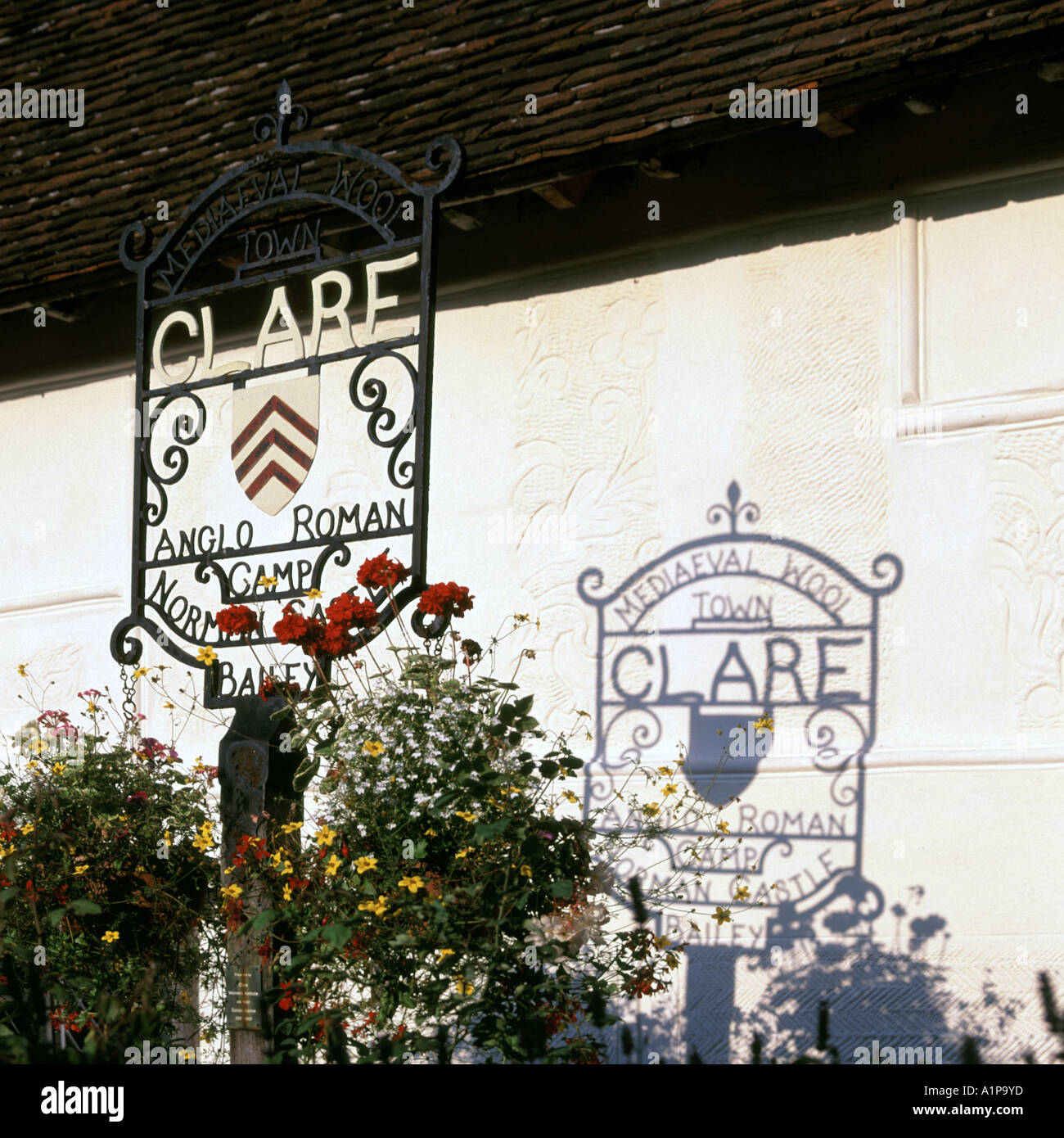 Clare medieval wool town wrought iron sign and shadow cast onto adjacent building - Stock Image