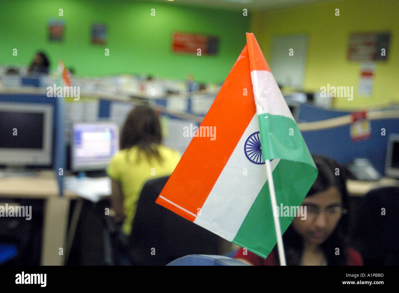 Indians work at a call center where business is outsourced from western companies in New Delhi in India. - Stock Image