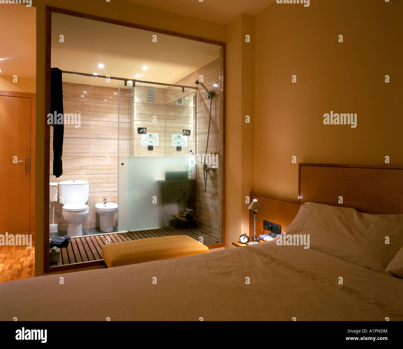 View Of A Bedroom With An Attached Bathroom