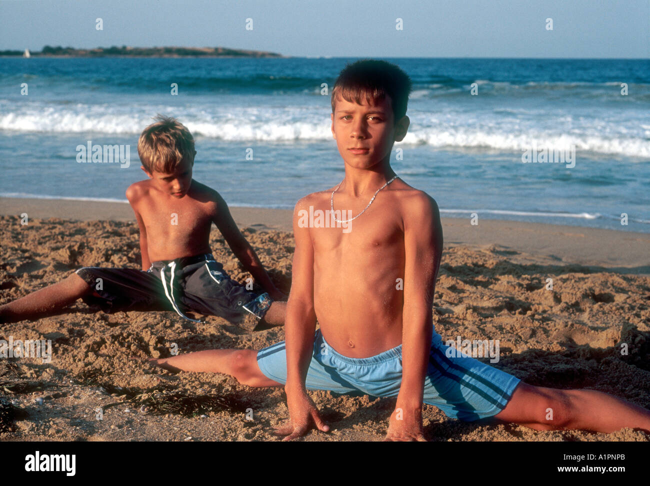 boys stretching on the beach S...