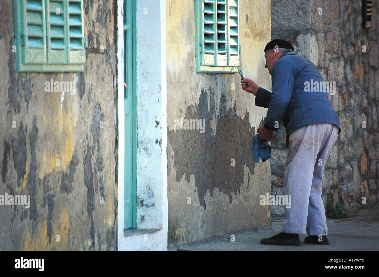 Old man is painting his house Stock Photo: 5893496 - Alamy