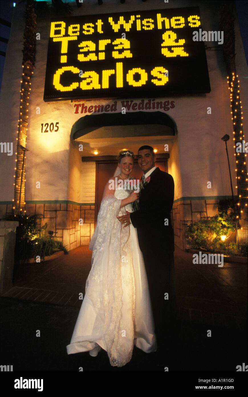 A Happy Couple Enter The Las Vegas Night After Their Wedding