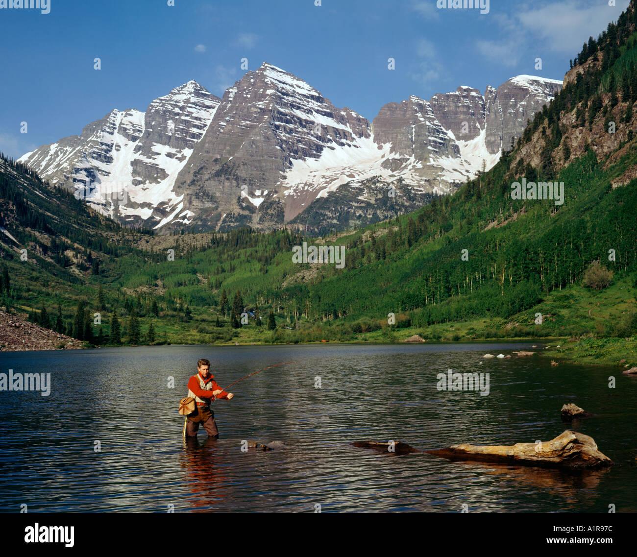 Man Fishing Maroon Bells Mountain Range Near Aspen
