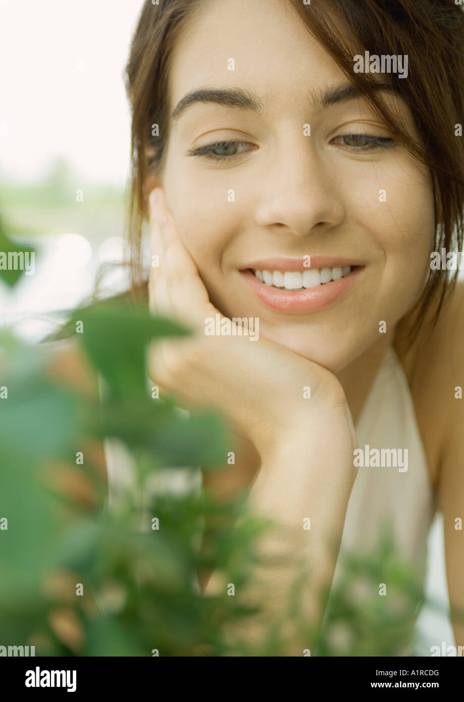 Young woman with plant - Stock Image