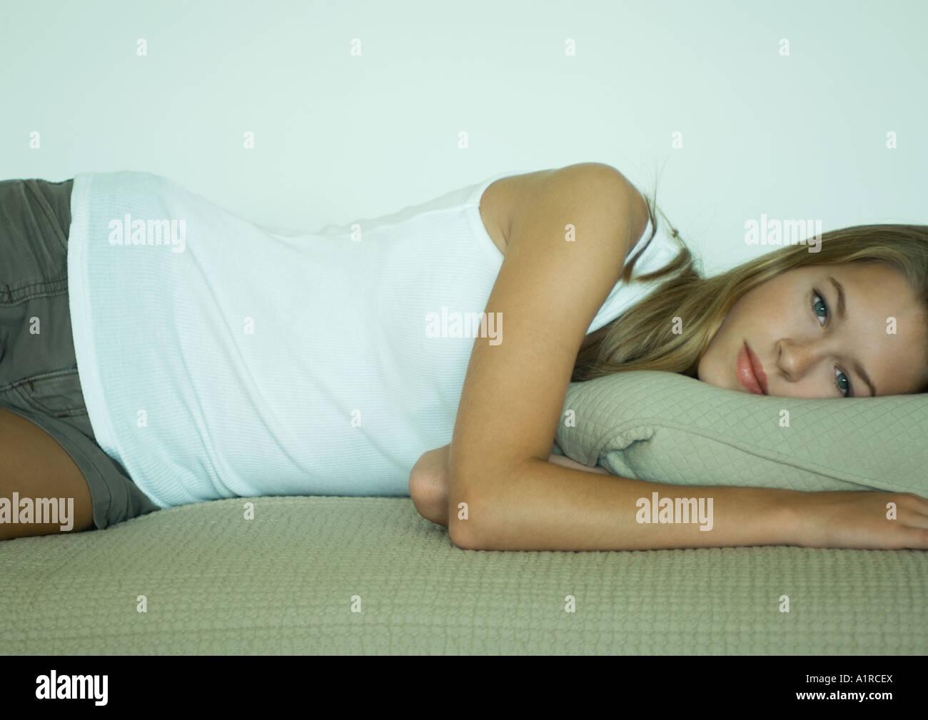 Woman lying on side - Stock Image