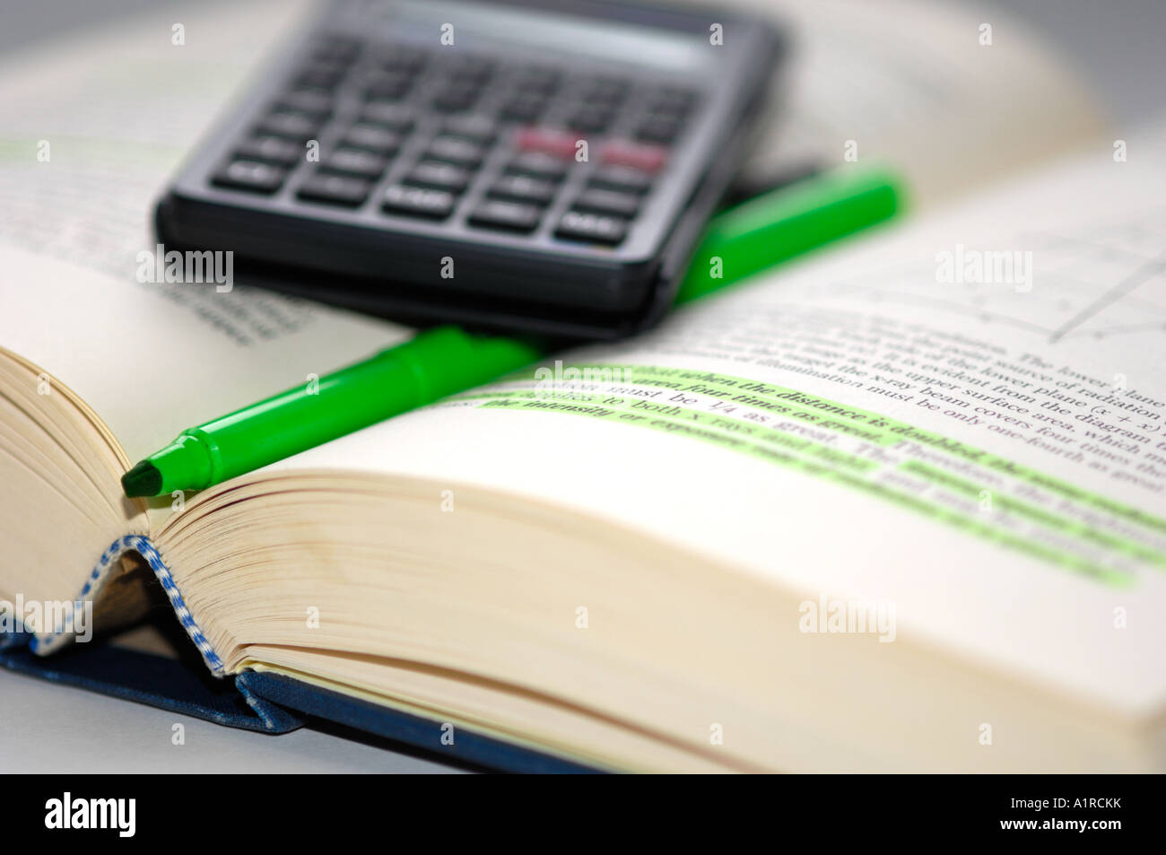 Studying text with calculator - Stock Image