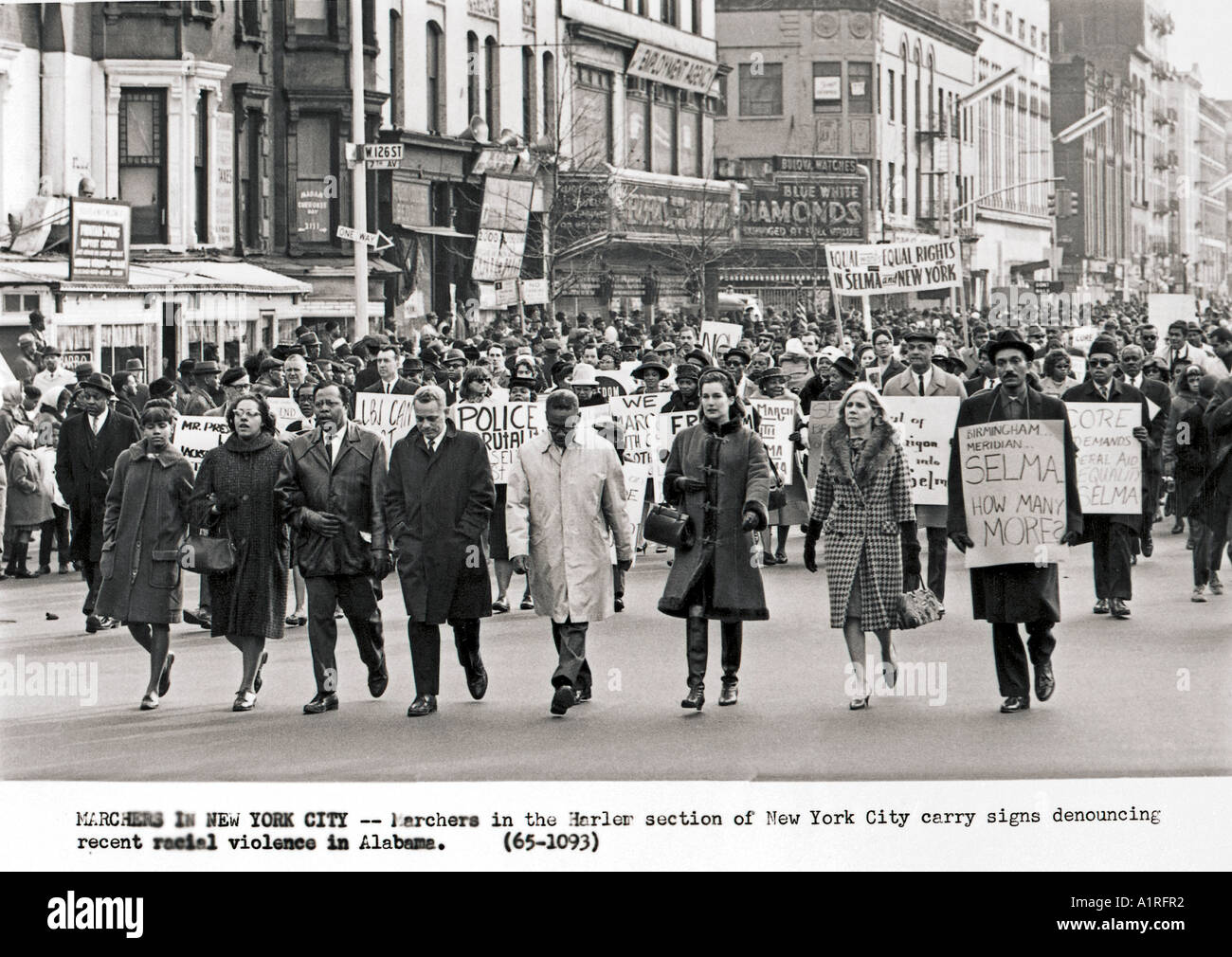 Marchers in Harlem New York City carry signs denouncing recent violence in Selma Alabama - Stock Image