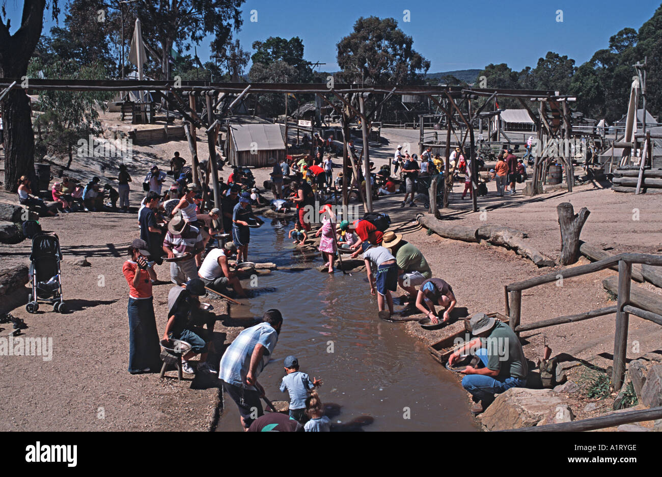 Visitors trying their hands at gold prospecting at Sovereign Hill theme park attraction Ballarat Victoria Australia - Stock Image