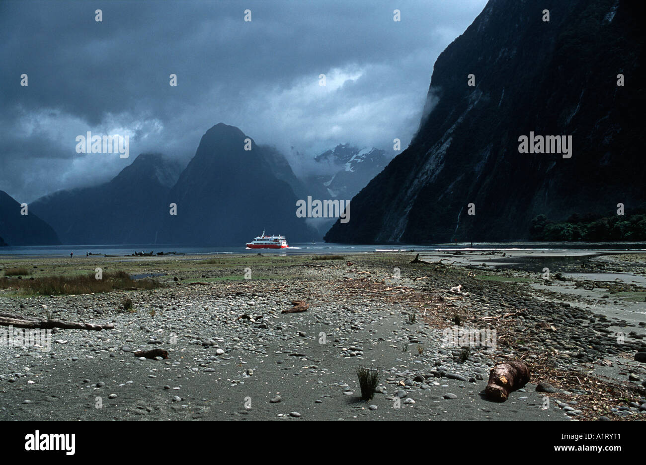 Milford Sound actually called Milford Fiord Fiordland National Park New Zealand Moody skies - Stock Image