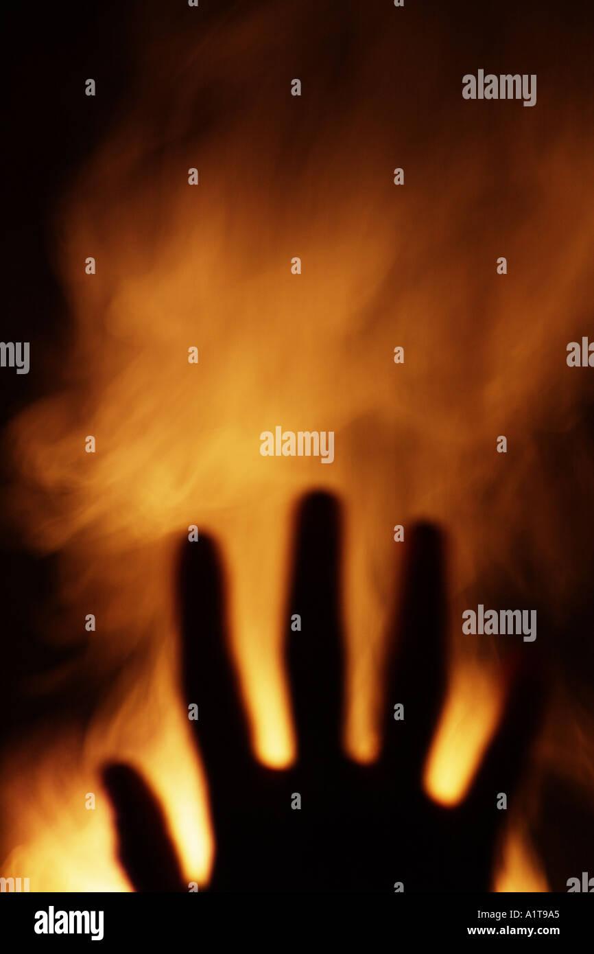 Hand and smoke - Stock Image