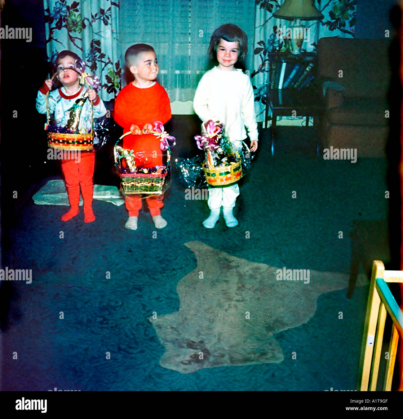 1950's Family Retro Photo,  Children Holding Easter Baskets at Home in Living Room, Vintage Stock Photo