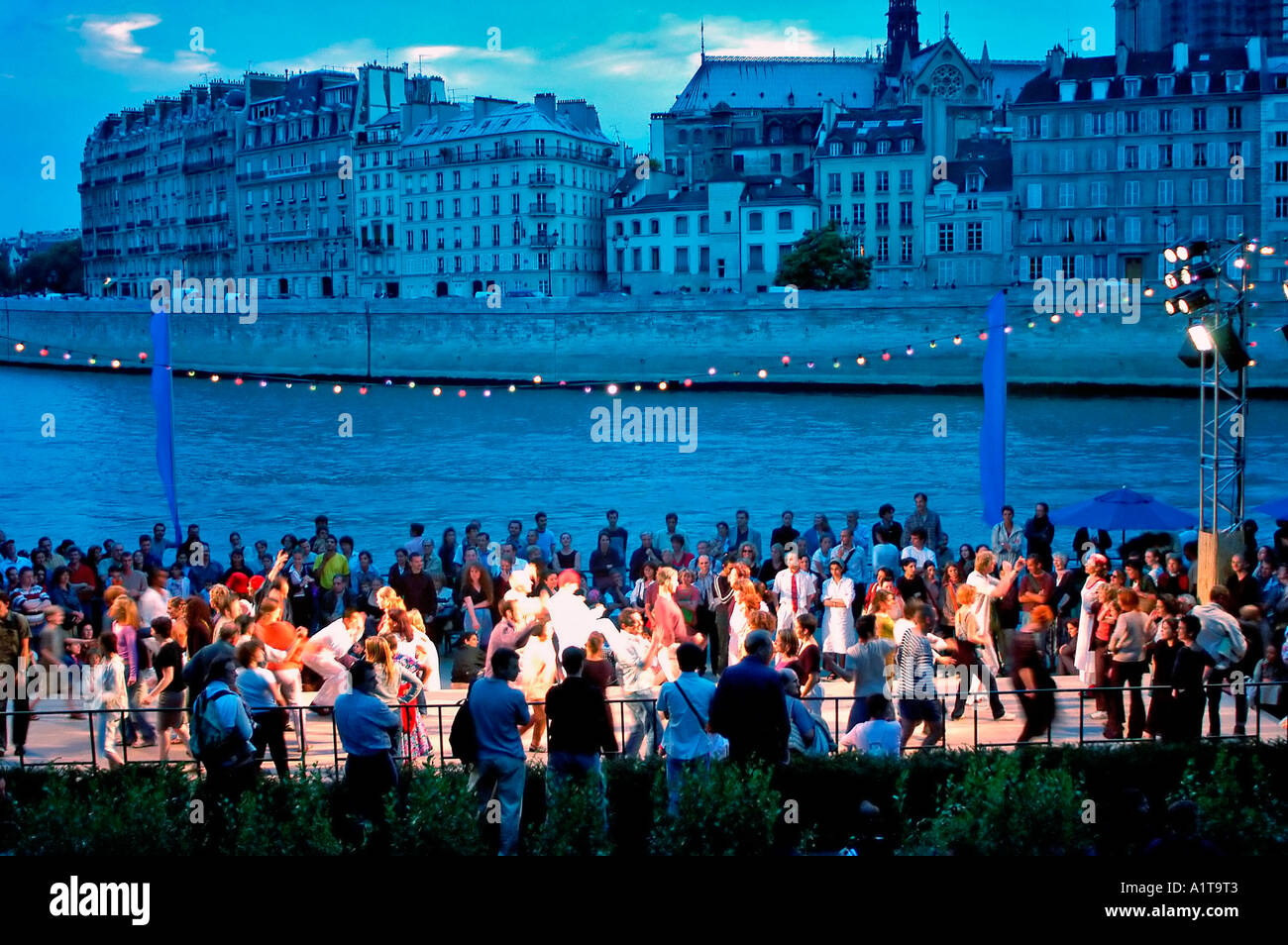 Paris France, Group of Mixed French Adults Dancing on River Seine plage, Bank, at 'Paris Plages' Summer Festival at Dusk, paris beach seine - Stock Image