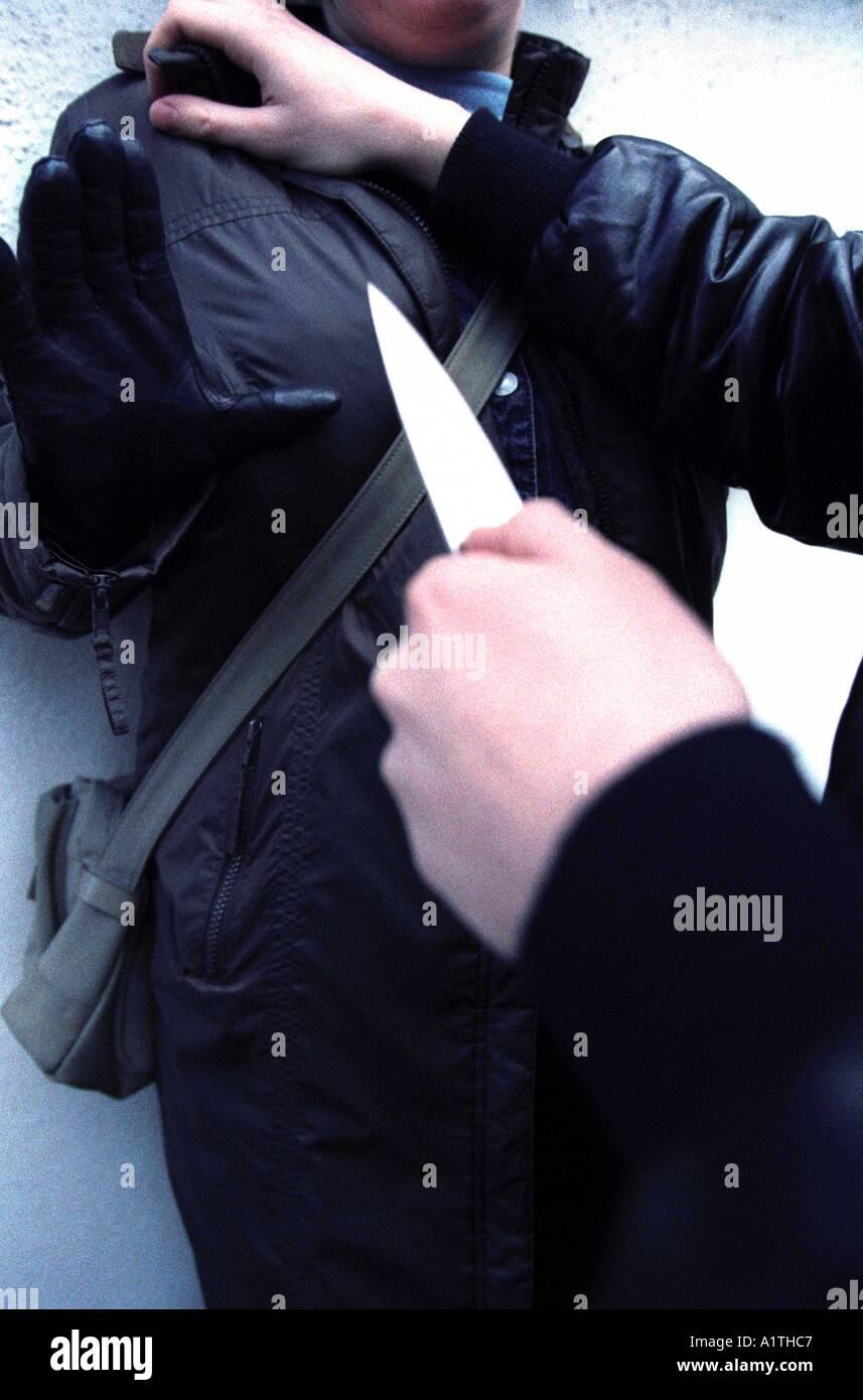 Street crime posed by model knife crime - Stock Image