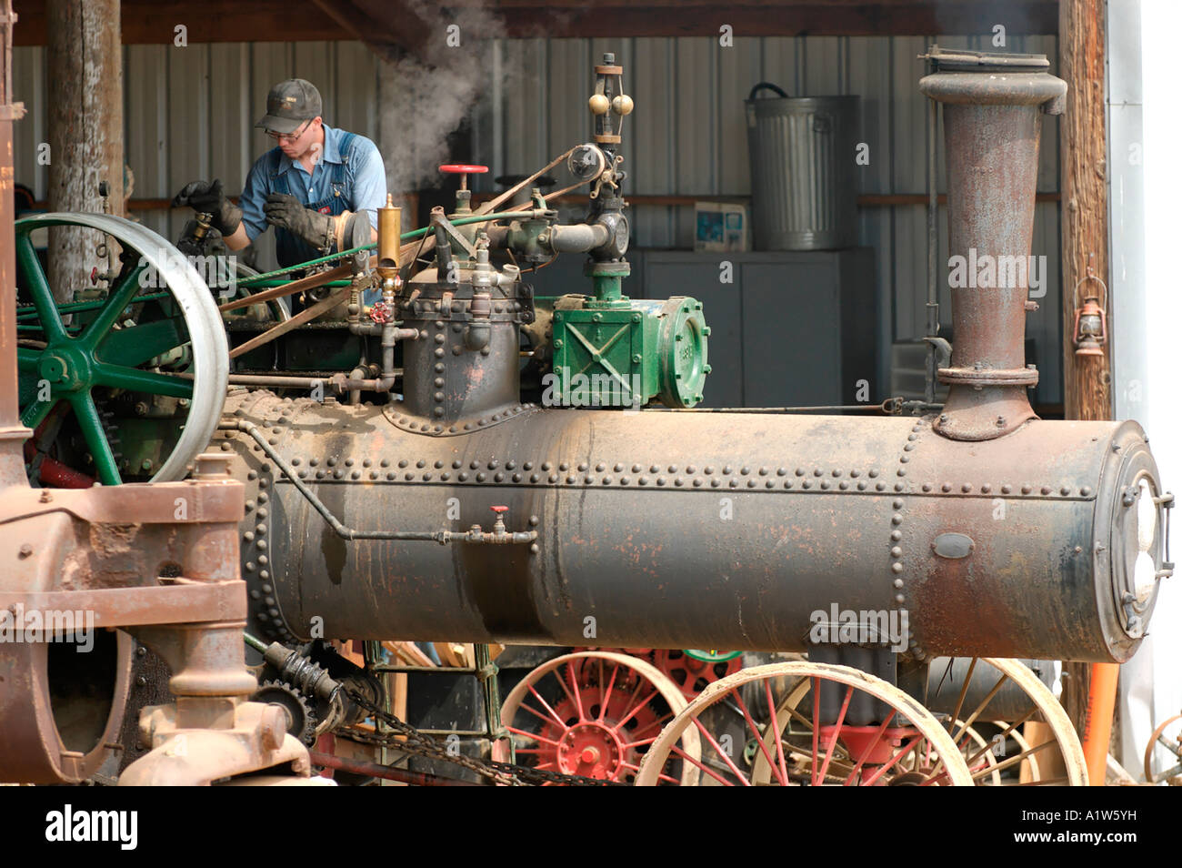 Man working on old steam tractor Antique Gas and Steam Engine Museum ...
