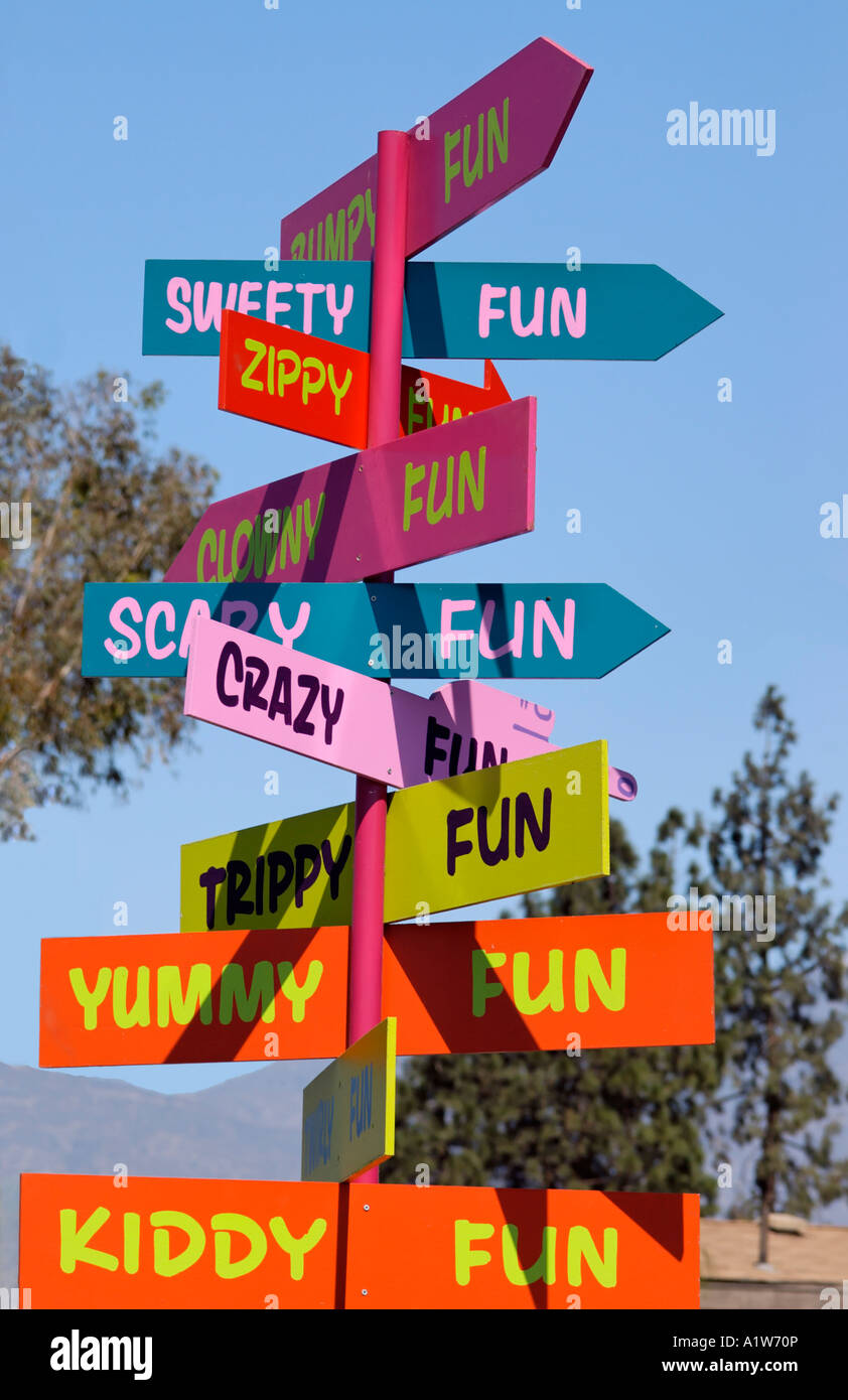 Carnival signs pointing out the fun at Los Angeles County Fair Pomona California USA - Stock Image