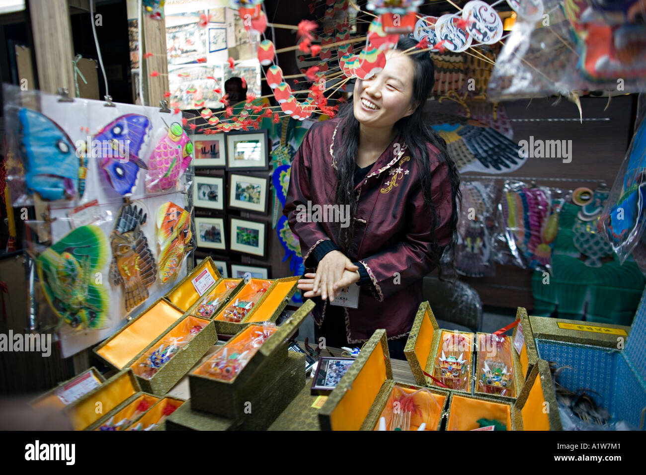 CHINA SHANGHAI Licensed Chinese artisan sells her hand made oriental kites at an open air market in Shanghai - Stock Image