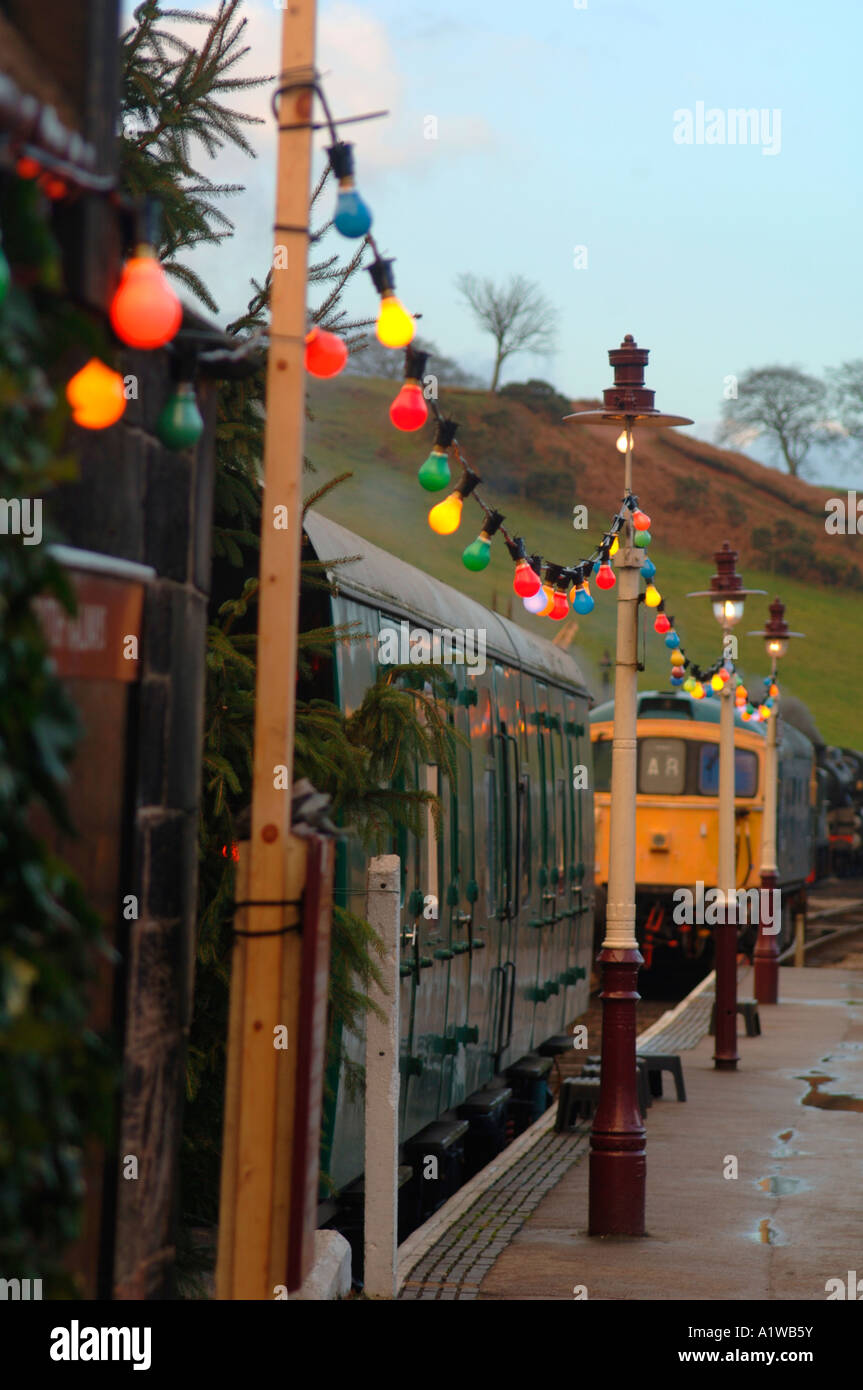Christmas Lights Hanging Along A Railway Platform (Churnet Valley Railway Cheddleton Staffordshire) - Stock Image